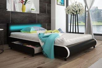 Skórzane tapicerowane łóżko z szufladami czarne 140 x 200 cm